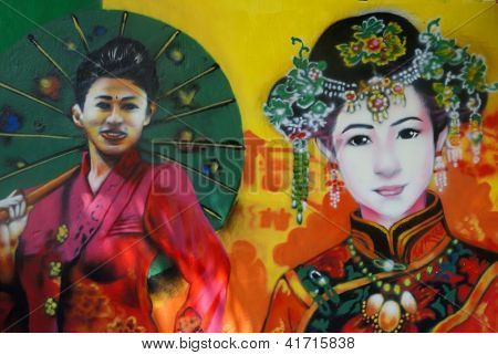 MALACCA, MALAYSIA-JAN.31: Street mural depicting woman of Nyonya Baba ethnic  in Malacca on Jan.31, 2013.  Nyonya Baba ethnic has a unique culture which retains Chinese customs and Malay traditions.