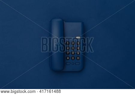 Landline Phone On Classic Blue Background. Color 2020. Top View