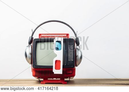 Red Retro Old Portable Mini Tv Set With Headphones, 3d Glasses On White Background. Attributes 80s,