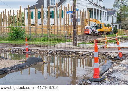 New Orleans, La - March 24: New House Construction, Road Repairs, And Flooded Street In Old Uptown N
