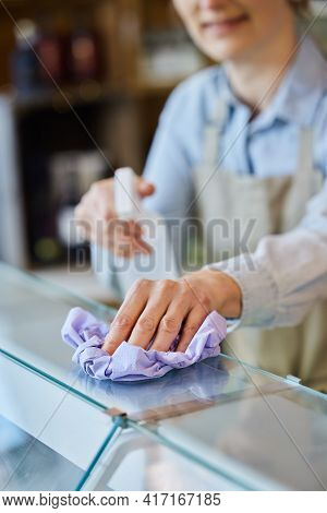Female Owner Delicatessen Cleaning Counter With Sanitising Spray