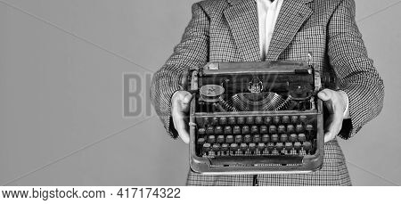 New Technology In Modern Life. Man Working On Retro Typewriter In Library. Mechanical Vs Digital. Wr