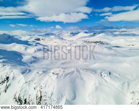 Spectacular Panoramic View Over Snowcapped Mountain Peaks, Ridges And Frozen Highland Tundra In Jotu