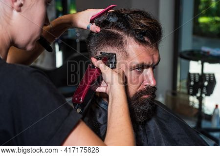 Professional Care For Face. Male Trendy Hairdo. Perfect Haircut With Blade Razor. Barber Master Cut