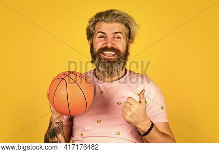 Basketball Player On Yellow Background. Hipster Basketball Player. Sport Concept. Enjoy Game. Play W