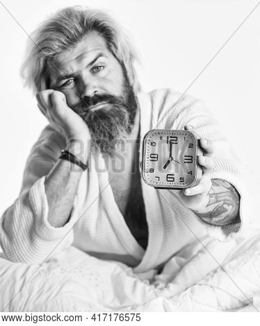 Awakening Concept. Insomnia Sleep Disorder. Healthy Habits And Lifestyle. Bearded Man With Alarm Clo