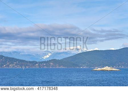 Howe Sound Islets Bc. A Sunny Day On Howe Sound With The Coast Mountains In The Background, British