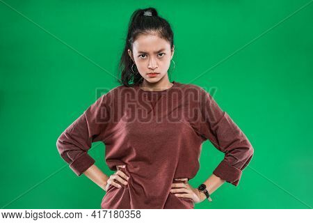Young Asian Woman With Hands At Her Hips While Expression Pissed Off The Face