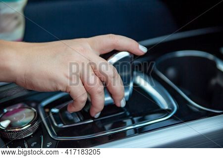 Hand Switches Modes On The Automatic Transmission Lever. Close-up. No Face. Driver Woman Hand Holdin