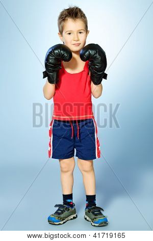 Portrait of a sporty boy engaged in boxing. poster