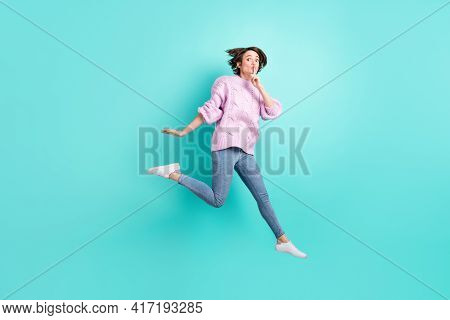 Full Length Photo Of Cute Funny Young Woman Wear Violet Sweater Jumping Ask Not Tell Secrets Isolate