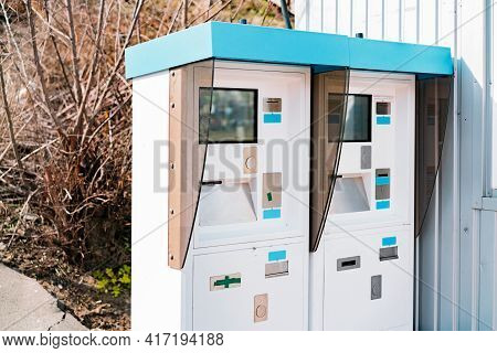 Electronic Ticket Dispensers Installed Outdoor Near Entrance On A Railway Station. Automatic Ticketi