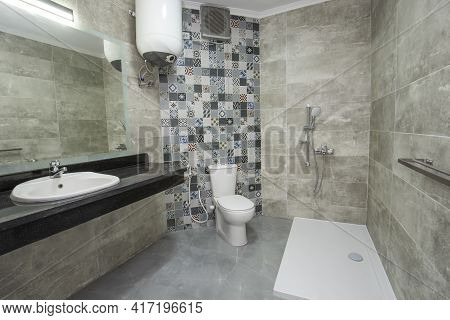 Interior Design Of A Luxury Show Home Bathroom With Disabled Access Shower Wet Room And Sink