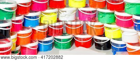 Screen Printing Ink In A Variety Of Bright Colors Is Laid Out In A Panoramic Semicircle And Stacked