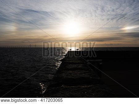 Halo Over The Oresund Bridge And A Pair Of Seagulls