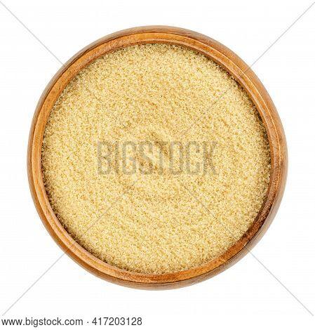 Demerara Sugar In A Wooden Bowl. Natural Raw Sugar, A Sucrose Sugar Product With Distinctive Yellow-