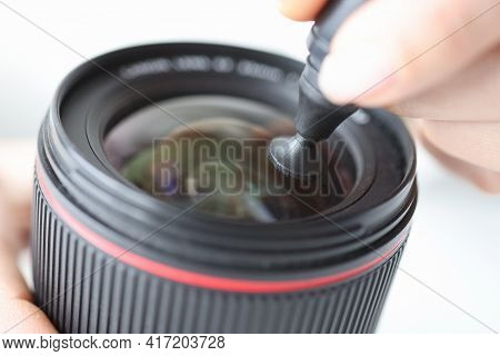 Photographer Serves Lens In Camera Lens With Cleaning Pencil