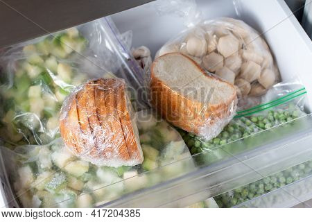 Frozen Bread In The Home Freezer, Baguette In Reserve On A Shelf Of A Home Freezer, Long Life Food S