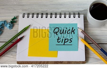 Quick Tips - Words On A Note Sheet Against The Background Of A Cup Of Coffee, Pencils. Business Conc