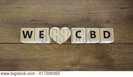 We Love Cbd Symbol. Wooden Cubes And Wooden Heart With Words 'i Love Cbd'. Beautiful Wooden Backgrou