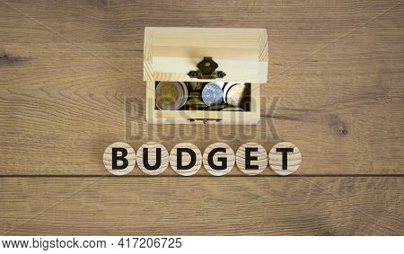 Budget Symbol. Concept Word Budget On Wooden Cubes On A Beautiful Wooden Background, Small Wooden Ch