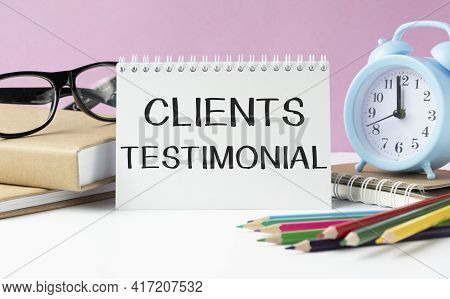 Client Testimonials Memo Written On A Notebook With Colored Pencils