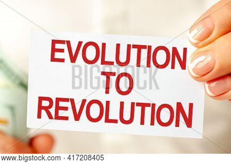 On The Table Are Bills, A Bundle Of Dollars And A Sign On Which It Is Written - Evolution To Revolut
