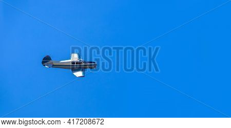 A Small Charter Single Propeller Plane Flies In The Clear Blue Sky On Private Business Flights, Nobo