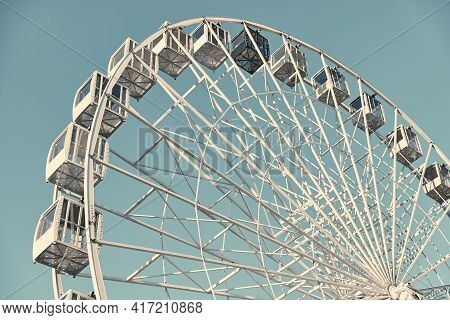 Ferris Wheel On A Background Of Turquoise Sky. White Ferris Wheel On A Sunny Day.