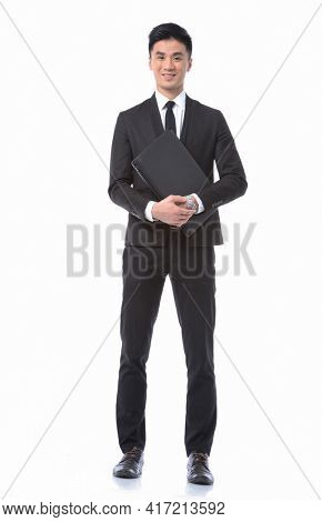 Full body Man business black suit ,tie with black pants ,shoes holds a notebook posing in studio