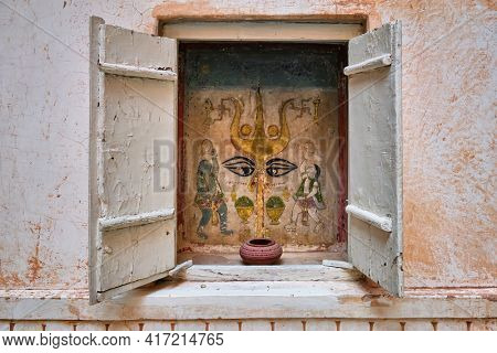 Mural with trident of the Hindu god Shiva in the Mehrangarh Fort, Jodhpur, Rajasthan, North India, India