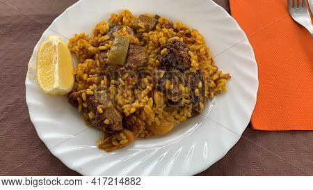 Valencian Paella. Typical dish of the Valencian Community made with rice, chicken, rabbit and vegetables from the Valencian garden.