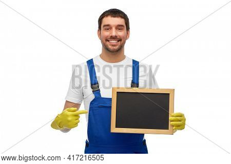 profession, cleaning service and people concept - happy smiling male worker or cleaner showing chalkboard over white background
