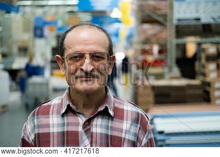 Elderly Man With A Mustache, Glasses, And A Plaid Shirt Looks At The Camera. Optometry