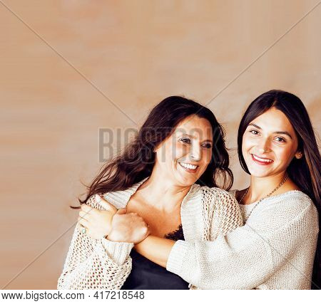 Cute Pretty Teen Daughter With Mature Mother Hugging, Fashion Style Brunette Makeup Together, Warm C