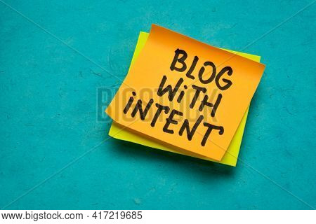 blog with intent advice or reminder - handwriting on a sticky note, content creation concept