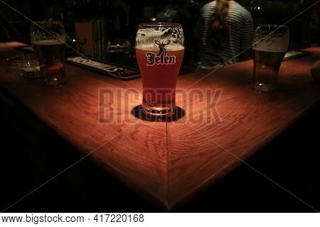 Belgrade, Serbia - September 12, 2014: Selective Blur On A Glass Of Jelen Pivo Beer On A Counter Of