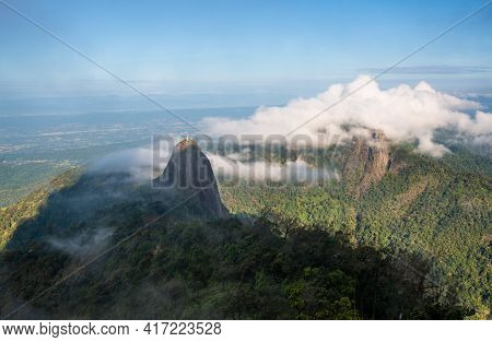 View Of Doi Nork In The Shadow Of Doi Luang An Iconic Huge Grey Black Rock In Doi Luang National Par