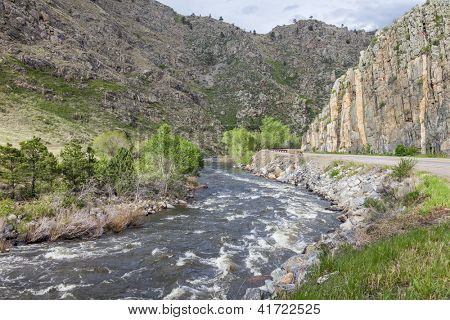 Cache la Poudre RIver and highway in canyon west of Fort Collins, Colorado, springtime flow