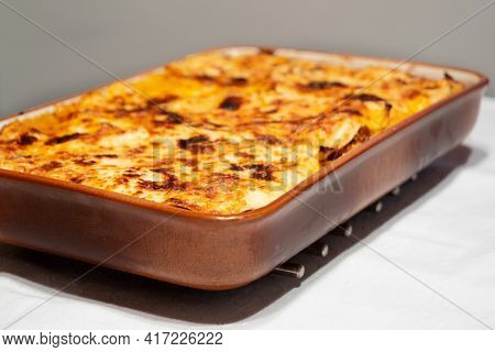 Lasagne Alla Bolognese, Baked With Meat Ragu On A White Plate Served As A Whole Family Style