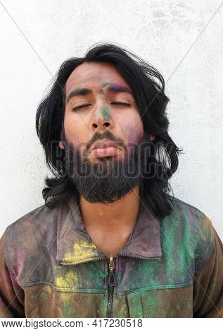 Close Up Of Handsome Young Man Covered With Multi Color Holi Powder With White Background, Bearded A