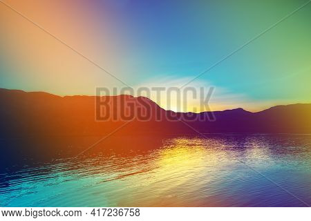 Fjord At Sunset, Rocky Beach In Evening. Silhouette Of Rocks Against Colorful Sunset Sky. Lofoten, N