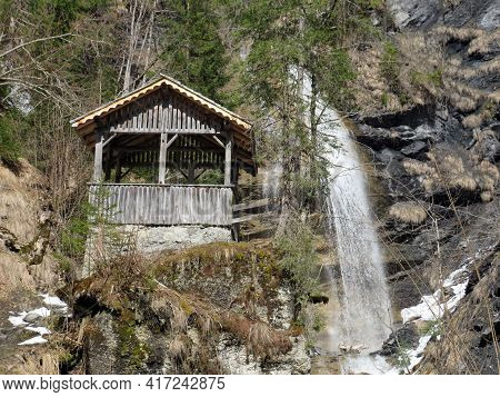 Wooden Hut By The Waterfall On The Stream Le Torrent Or Le Torrentfall (cascade Du Torrent), Les Dia