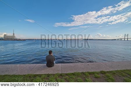 Saint-petersburg, Russia - August 8, 2020: Man On The Embankment Between The Marine Station And The