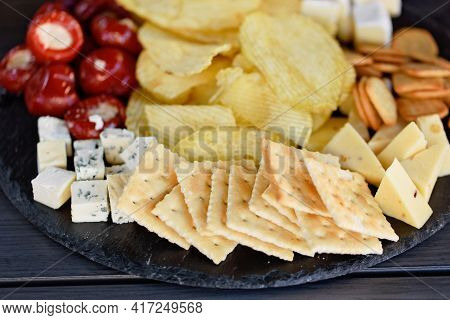 Mix Of Different Snacks And Appetizers. Street Food Plate With Set Of Various Kind Snacks: Bread Spi
