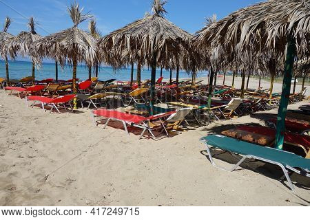 A Beach Bar In Chalkidiki Greece With Empty Sunbeds And Umbrellas