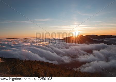 Photo Shoot Of Sunset On Lysa Hora With A View Of Smrk Mountain In Beskydy Mountains. Clouds Flow Ar