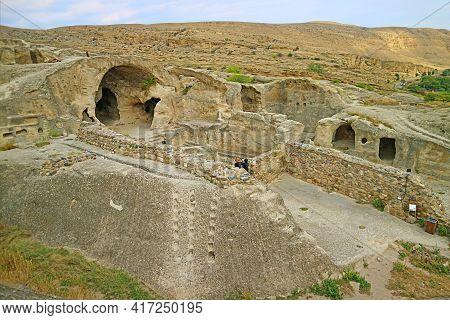 The Ancient Uplistsikhe Cave Town On The Rocky Massif Of Mtkvari Riverbank In Shida Kartli Region, H