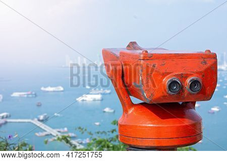 Red Tourist City Binoculars On An Resort Town In Thailand, Panorama Of The City Of Pattaya And Red B