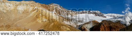 Panorama View Of The Opasny Canyon Near The Mutnovsky Volcano. The Depth Of The Canyon Surprises Wit